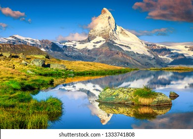 Fantastic photography and hiking location, wonderful morning lights with spectacular Matterhorn and gorgeous Stellisee lake. Beautiful touristic place in Switzerland near Zermatt, Europe