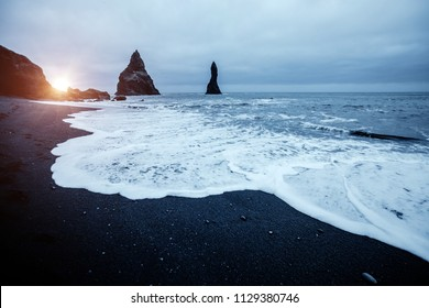 "Fantastic place of the stormy Atlantic ocean. Basalt rocks ""Troll toes"". Location Reynisfjara Beach, Iceland (Sudurland), Europe. Scenic image of popular european travel destination. Beauty of earth."