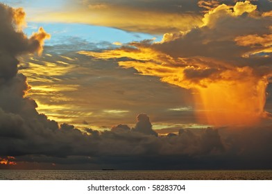 Fantastic sky (original colours) iluminated by the sunset light before the rain over the ocean. Maldives.