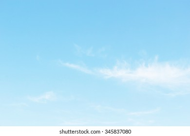 Fantastic soft white clouds against blue sky background, soft focus. - Shutterstock ID 345837080