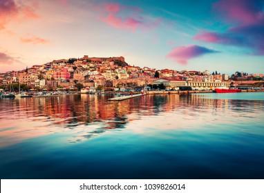 Fantastic spring seascape on Aegean Sea. Coloful evening view of Kavala city, the principal seaport of eastern Macedonia and the capital of Kavala regional unit. Greece, Europe.