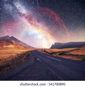 Fantastic starry sky and majestic mountains in the mist. Dramatic and beautiful morning. Autumn landscape. Courtesy of NASA.