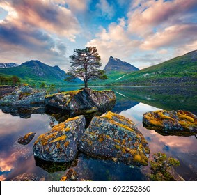 Fantastic summer sunrise on the Innerdalsvatna lake. Colorful morning scene in Norway, Europe. Beauty of nature concept background. Artistic style post processed photo.