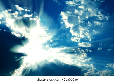 Fantastic sun rays are striking through the clouds like an explosion