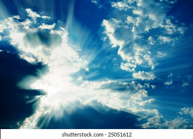 Fantastic sun rays striking through clouds