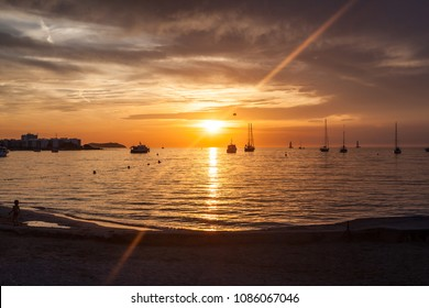 Fantastic sun set over San Antonio bay, Ibiza - A wonderful sun flare with moored boats silhouetted against the setting sun