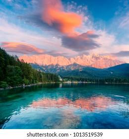 Fantastic sundown on mountain lake Eibsee, located in the Bavaria, Germany. Dramatic unusual scene. Alps, Europe. Landscape photography