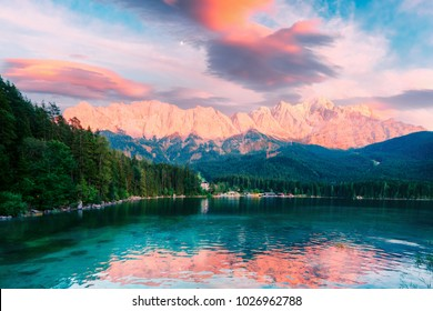 Fantastic sundown on mountain lake Eibsee, located in the Bavaria, Germany. Dramatic unusual scene. Alps, Europe. Landscape photography