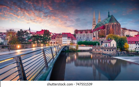 Fantastic sunrise view of St Peter and Paula's Church, on the Polish border. Colorful autumn cityscape of Gorlitz, eastern Germany, Europe. Traveling concept background.