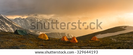 Fantastic Sunset During Thunderstorm Tent Camp Stock Photo
