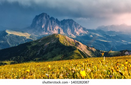 Fantastic sunset in the mountains. Great view of famous Sassolungo peak with overcast Dramatic sky. Wonderful Vall Gardena under sunlight. Majestic Dolomites Mountains. Amazing nature Landscape