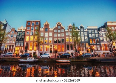 Fantastic sunset that shines on buildings and reflected in the water. Amsterdam is the capital and most populous city in Netherlands.