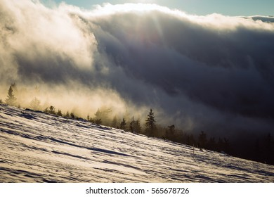 Fantastic sunset winter landscape. Dramatic sky with fog