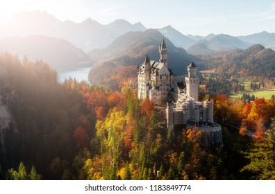 Fantastic sunshine over the majestic Neuschwanstein castle during sunset.  near Munich in Bavaria, Germany. Popular Photography Locations. Ideas for Great Travels. Beautiful of the world for travel.