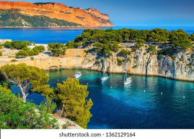 Fantastic vacation place, stunning viewpoint on the cliffs, Calanques de Port Pin bay with yachts and sailing boats, Calanques National Park near Cassis, Provence, South France, Europe