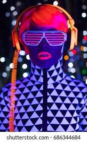 fantastic video of sexy cyber raver woman filmed in fluorescent clothing under UV black light