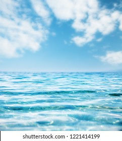 Fantastic view of the azure sea. Clear sky on a sunny day with white fluffy clouds. Mediterranean climate. Scenic image of wallpaper. Splendid and gorgeous morning scene. Vibrant seascape background.