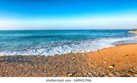 Fantastic view azure sea glowing by sunlight. Dramatic morning scene. Location Makauda, Sciacca. Sicily, Southern Italy, Europe