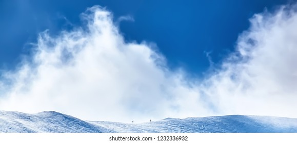 The Fantastic view of the azure sky on a sunny day with fluffy clouds. Scenic image of textured sky. Stunning wallpaper. Winter background