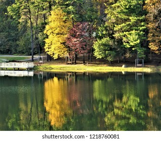 Fantastic view of colorful leaves on the trees with reflection in the lake at Vogel State park , Autumn in GA USA.