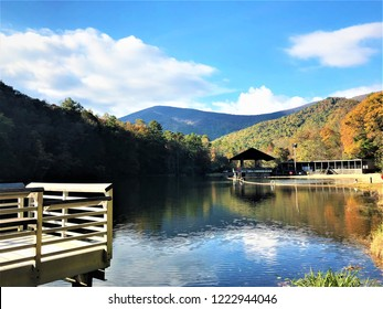 Fantastic view of colorful mountain with reflection in the lake at Vogel State park with blue sky white clouds on the background, Autumn in GA USA.