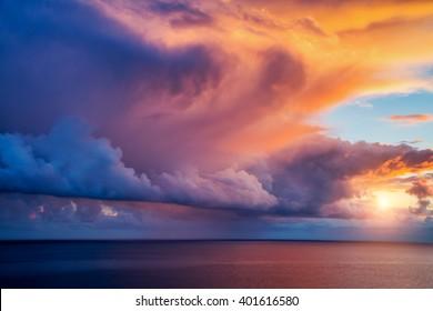 Fantastic view of the dark overcast sky. Dramatic and picturesque morning scene. Location: cape Capo Zafferano. Island Sicilia, Italy, Europe. Mediterranean and Tyrrhenian sea. Beauty world.