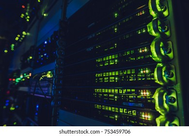 Fantastic view of the mainframe in the data center rows. Big data center full of rack servers. Data centre interface.