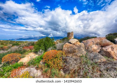Fantastic view on Lagoon of Porto Giunco with turquoise water and old tower. Location: Villasimius, Cagliari region, Sardinia, Italy, Europe