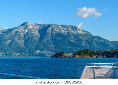 Fantastic view over ocean, snow mountain and rocks at Sechelt inlet in Vancouver, Canada.