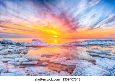 Fantastic view of the sea landscape with ice floe. Sunset at the Baltic sea