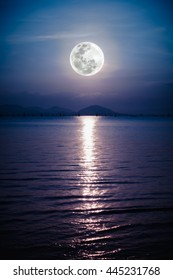 Fantastic view of the sea. Romantic scenic with full moon on sea to night. Reflection of moon in water. The moon were NOT furnished by NASA.