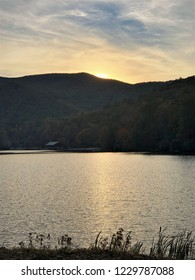Fantastic view of sunset on the mountains with reflection in the lake at Vogel State park with blue sky and dramatic clouds on the background, Autumn in GA USA.