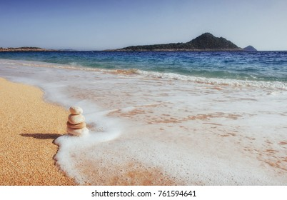 Fantastic views of the sea coast with yellow sand and blue water