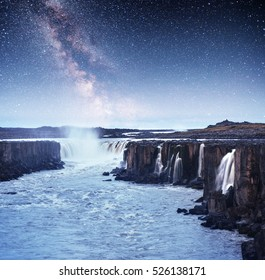 Fantastic views of Selfoss waterfall in the national park Vatnajokull. Iceland. Fantastic starry sky and the milky way.