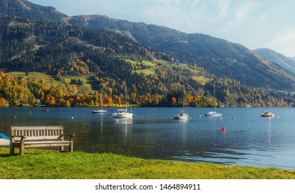 Fantastic views of the turquoise lake Zeller, under sunlight. Panoramic view on mountain lake with yachts, in front of mountain range. Awesome nature background. Landscape in Alps in sunny day.