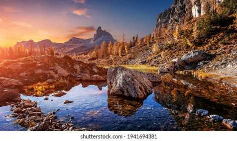 Fantastic Vivid nature landscape. Scenic image of Federa lake during sunset. Popular travel and hiking destination. Picture of wild area. Awesome nature Background. Concept of an ideal resting place.