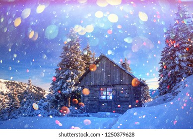Fantastic winter landscape with wooden house in snowy mountains. Christmas holiday postcard collage. DOF bokeh light postprocessing effect