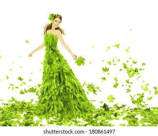 Fantasy beauty, fashion woman in seasons spring leaves dress. Creative beautiful girl turning in green summer gown, over white background.