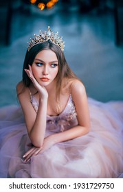 fantasy beauty girl princess in golden crown. Medieval vintage purple dress. Capricious attractive face. Historical woman lady glamorous queen. Fashion model posing emotional portrait. Blue background