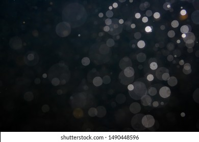Fantasy bokeh sparkle from light on black background