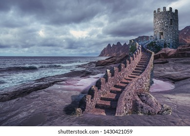 fantasy coastal landscape of an unreal Land with a castle on the rock