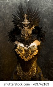 Fantasy, dark gothic dress formed by a silver metal tiara and a golden corset, handmade costume