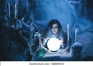 Fantasy Dark witch casts spell glowing crystal ball. spooky voodoo style. Gothic Spirit Skull Ghost Death black robe. Fabulous mystical concept deep forest. Halloween carnival holiday costume clothes