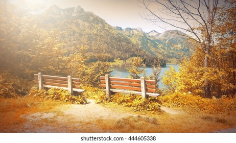 Fantasy fable scene effects applied. Bench on side walk by the Lake in the Europe and in the mountain.With copy space.