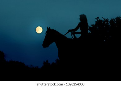 Fantasy full moon with dark silhouette of the horse rider. Horseback  riding, woman under moonlight. Atmosphere moonlight horror background for halloweens nightmare.