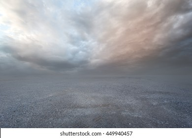 Fantasy gravel background with dramatic sky and grass