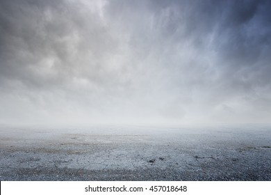 Fantasy gravel background with dramatic sky fog