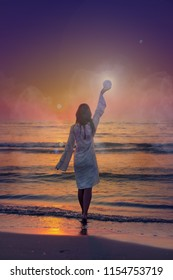 fantasy image of a beautiful woman at sea shore during dawn raising moon to sky