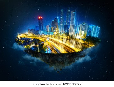 Fantasy island floating in the air with modern city skyline and network light came out from the ground ,modern city with wireless network connection concept  . Night scene .