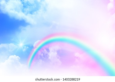 Fantasy Magic have Rainbow on sky abstract cloud pink purple pastel colors and sun light for use as beautiful background and have space to put letters